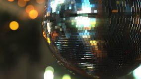 Turning mirror disco ball against bokeh background. Joy, dancing or party concepts stock footage