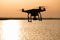 Rotating drone over golden lake surface royalty free stock photos