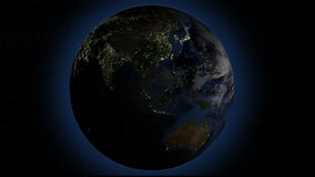 Rotating Earth with night lights, seamless looped 3d animation, blue outer glow stock footage