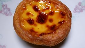 Rotating of egg tart on plate. Rotating of egg tart on white plate at home in Taipei Taiwan stock video footage