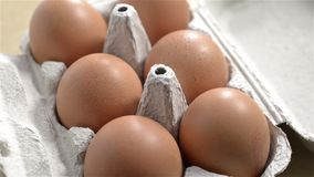 Rotating Eggs. Half a dozen brown eggs rotating. Seamless looping stock video footage