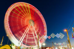 Rotating Ferris wheel. In motion located in Badajoz, Extremadura, Spain Stock Images