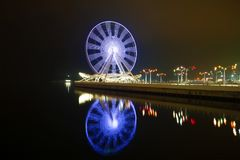 Rotating Ferris wheel on the shore of the Caspian Sea. Night Baku. Rotating Ferris wheel on the shore of the Caspian Sea, Night Baku stock photography
