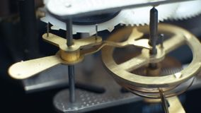 Rotating gears mechanical watches. Pendulum clock. 4K. Rotating gears mechanical watches. Pendulum clock stock footage
