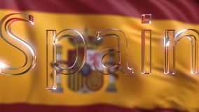 Rotating glass Spain caption against waving Spanish flag. 3D rendering Stock Photos
