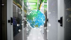 Rotating globe with pictures of different people around the world. Digital composite of server aisle while  globe with head shot pictures of people around the stock footage