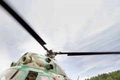 Rotating helicopter propeller blades. Rotating rotor of the helicopter close-up stock photos