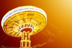 Rotating with high speed carnival attraction chain with bright l. Ights in amusement park Royalty Free Stock Photos