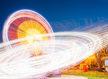 Rotating In Motion Effect Illuminated Attraction Ferris Wheel On Royalty Free Stock Photo