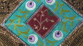 Rotating indian cloth background from India. Rotating indian decorated cloth background from India stock video