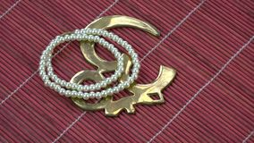 Rotating indian pearls necklace and OM sign symbol stock video