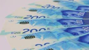 Rotating israeli money bills of 200 shekel stock footage