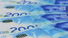 Rotating israeli money bills of 200 shekel stock video