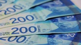 Rotating israeli money bills of 200 shekel stock video footage