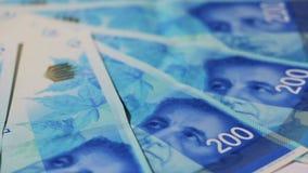 Rotating israeli money bills of 200 shekel - top view stock video