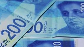 Rotating israeli money bills of 200 shekel - top view stock video footage