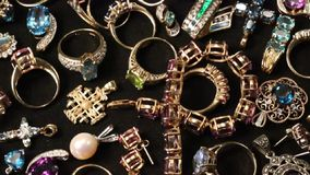 Rotating Jewelry - HD. Collection of gems, rings, earrings, pendants and other jewels stock video footage