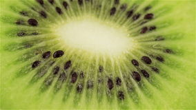 Rotating kiwi slice, macro. Fresh and healthy organic food. Rotating Half of a Ripe Kiwi stock video footage
