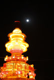 Rotating lantern and the full moon Stock Images