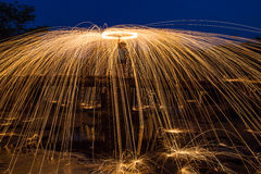 Rotating lights. Rotating fire works with plenty of sparks Royalty Free Stock Photos