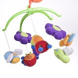 Rotating mobile with soft toys on a child´s bed Stock Image