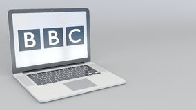 Rotating opening and closing laptop with British Broadcasting Corporation BBC logo. Computer technology conceptual. Editorial 4K clip ProRes stock video