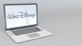 Rotating opening and closing laptop with Walt Disney Pictures logo. Computer technology conceptual editorial 4K clip. ProRes vector illustration