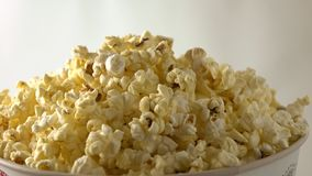Rotating paper box of popcorn. 4K clip. Rotating paper box of popcorn. 4K shot stock video footage
