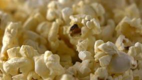 Rotating paper box of popcorn. 4K macro clip. Rotating paper box of popcorn. 4K macro shot stock footage