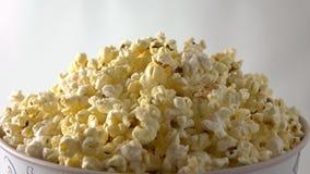 Rotating paper box of popcorn. 4K video. Rotating paper box of popcorn. 4K shot stock video