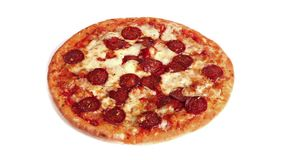 Rotating Pepperoni Pizza On Plain Background. Pizza turning slowly on plain white background stock video