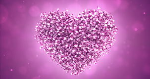 Rotating Pink Rose Sakura Flower Petals In Lovely Heart Shape Background Loop 4k. Rotating animation of romantic flying pink rose sakura flower petals in shape stock footage