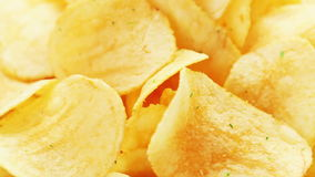 Rotating potato chips, food background stock footage