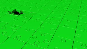 Rotating puzzle pieces in green stock footage
