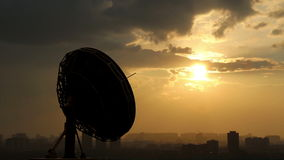 Rotating radio telescope at sunset Stock Image