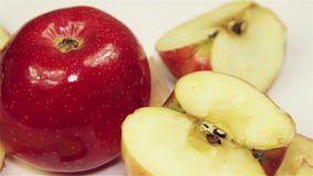 Rotating Red Apple - Overhead. Apples rotation on the table, close-up stock video