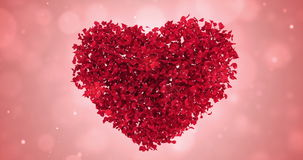 Rotating Red Rose Flower Petals In Lovely Heart Shape Background Loop 4k. Rotating animation of romantic flying red rose flower petals in shape of lovely heart stock video