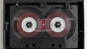 Rotating reels of audio cassette in old retro player. Vintage cassette tape player closeup stock video footage