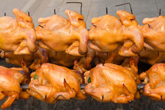 Rotating roast chicken. Royalty Free Stock Photo