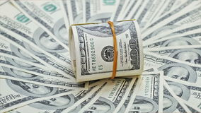 Rotating rolled up bundle of 100 dollar notes Royalty Free Stock Images
