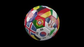 Soccer ball with flags of countries of world on transparent, 4k prores 4444 footage, alpha channel, loop. Rotating soccer ball with flags of the countries of the stock footage