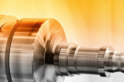 Rotating spindle of turning lathe and metal detail Royalty Free Stock Photography
