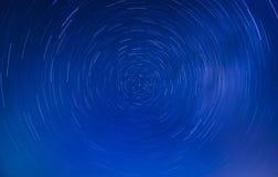 Rotating stars around a polar star stock image