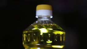 Rotating sunflower oil bottle. Looping continuous video stock video footage