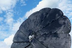 Rotating sunflower shaped solar panel detail with blue sky royalty free stock photography