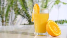 Rotating tangerine juice on the turntable stock video