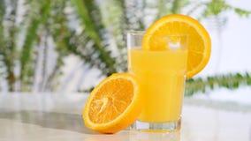 Rotating tangerine juice on the turntable stock footage