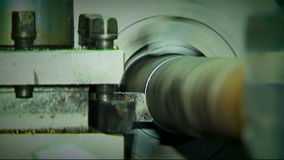 Rotating Turning Lathe In Process. Archival record. Rotating part of industrial turning lathe. Close-up. Archival record stock footage
