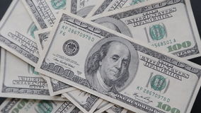 Rotating 100 US dollars bank notes. Business background stock footage