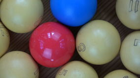 Rotating used colorful billiards balls with numbers. Rotating used colorful vintage billiards balls on table with numbers stock video
